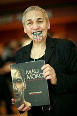 Ngahuia-Te-Awekotuku-with-book.jpg