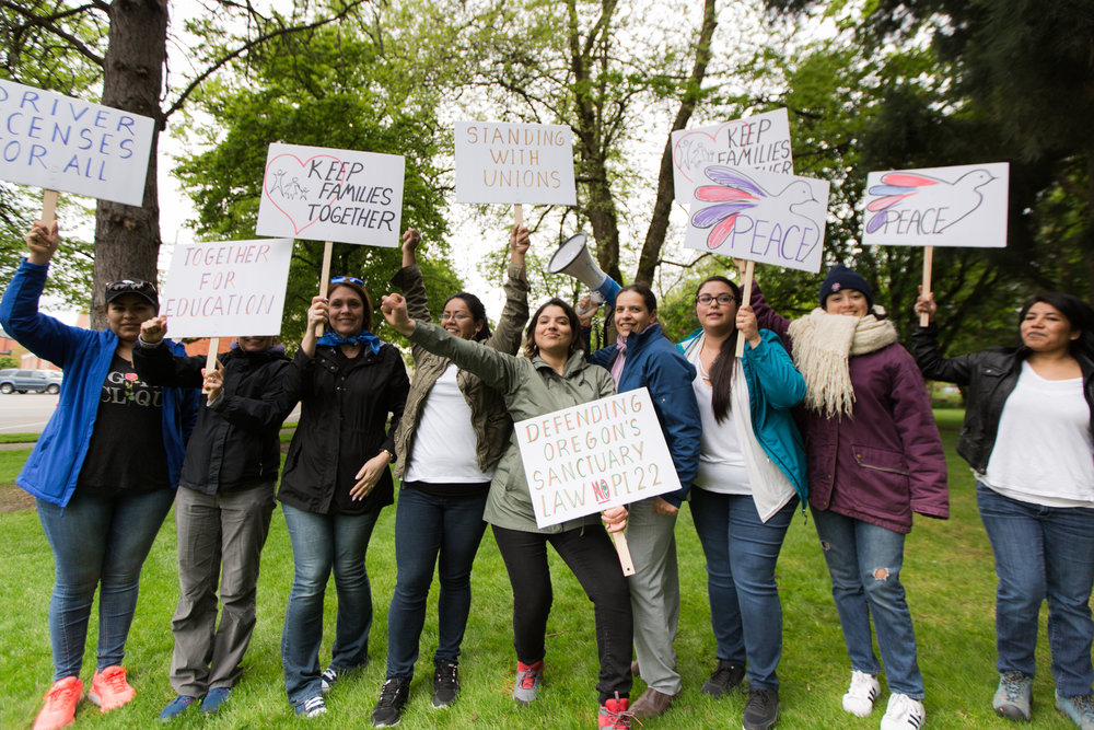 Members of the Adelante Mujeres staff march in the May Day Rally.