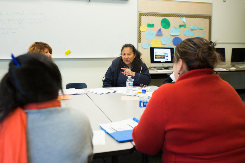 Women at Barnes Elementary, our new second location this year, participate in a discussion during class.