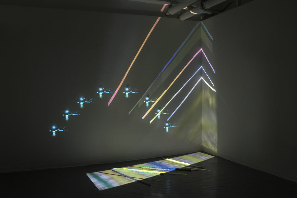 Untitled (Landing Strip and Constellation Arch), 2015, video documentation of installation including plastics, textile, two digital projectors, dimensions variable