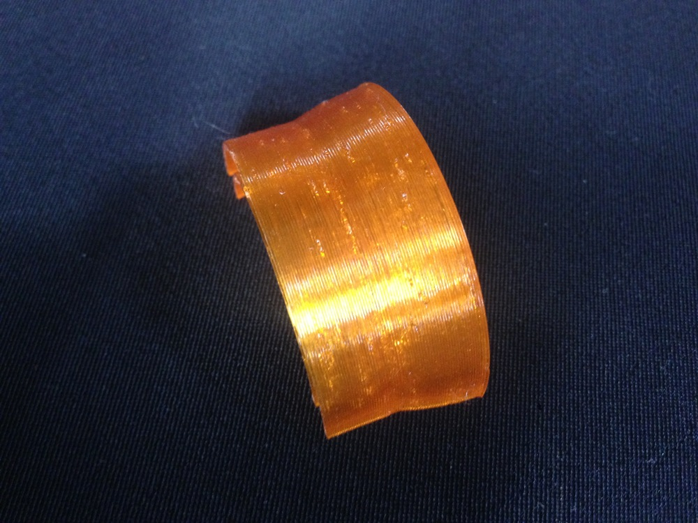 Pitting on the surface of this print.  Push Plastic Amber PETG w/ 150 mm/s retraction
