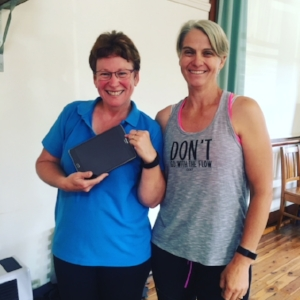Marie Harris receiving her tablet from her Active Farmers trainer Kim Broomby