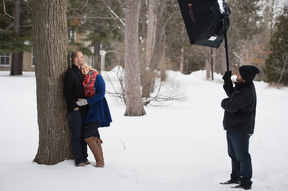 A couple laughing during their winter engagement photo shoot