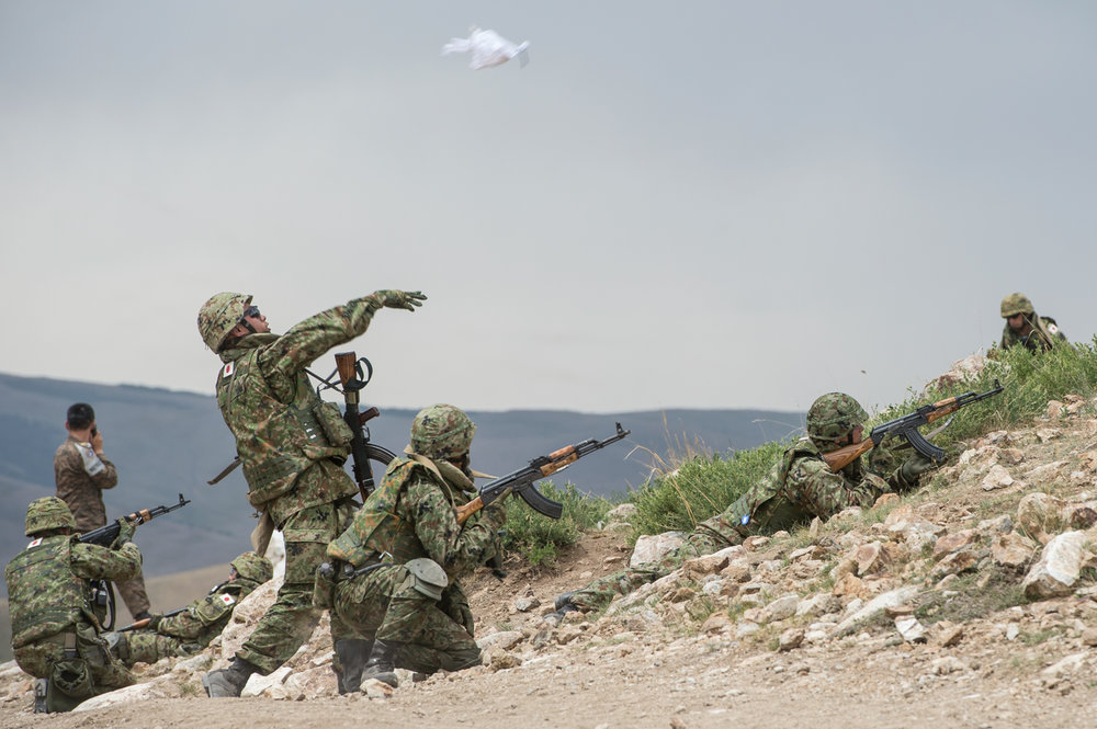 A photo by Corporal Andrew Wesley of troops from Japan responding to a simulated attack in the Gobi Desert