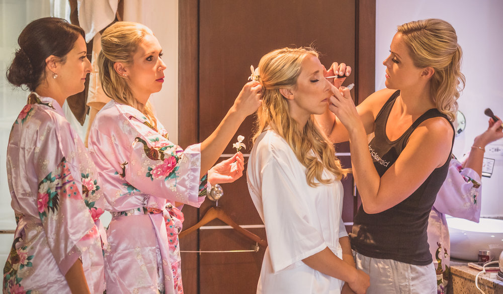 Laura getting her makeup and hair touched up on the morning of her wedding!
