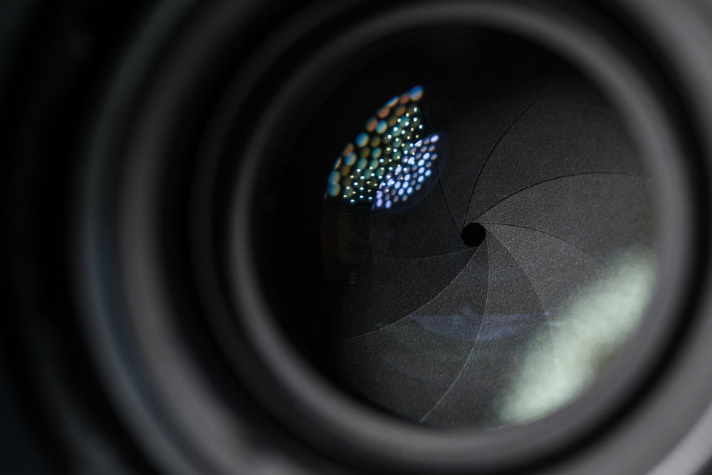 The aperture blades of a Nikon 50mm F/1.4 camera lens.