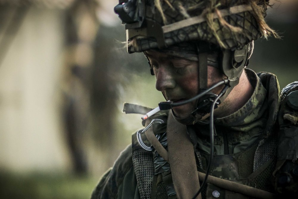 A Canadian Forces soldier smoking after an attack.
