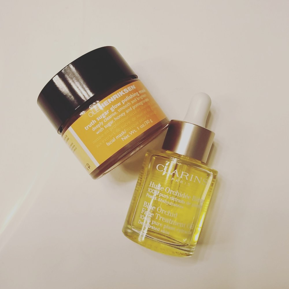Ole Henriksen - Truth Sugar Glow Polishing Mask (Left), and Clarins - Blue Orchid Face Treatment