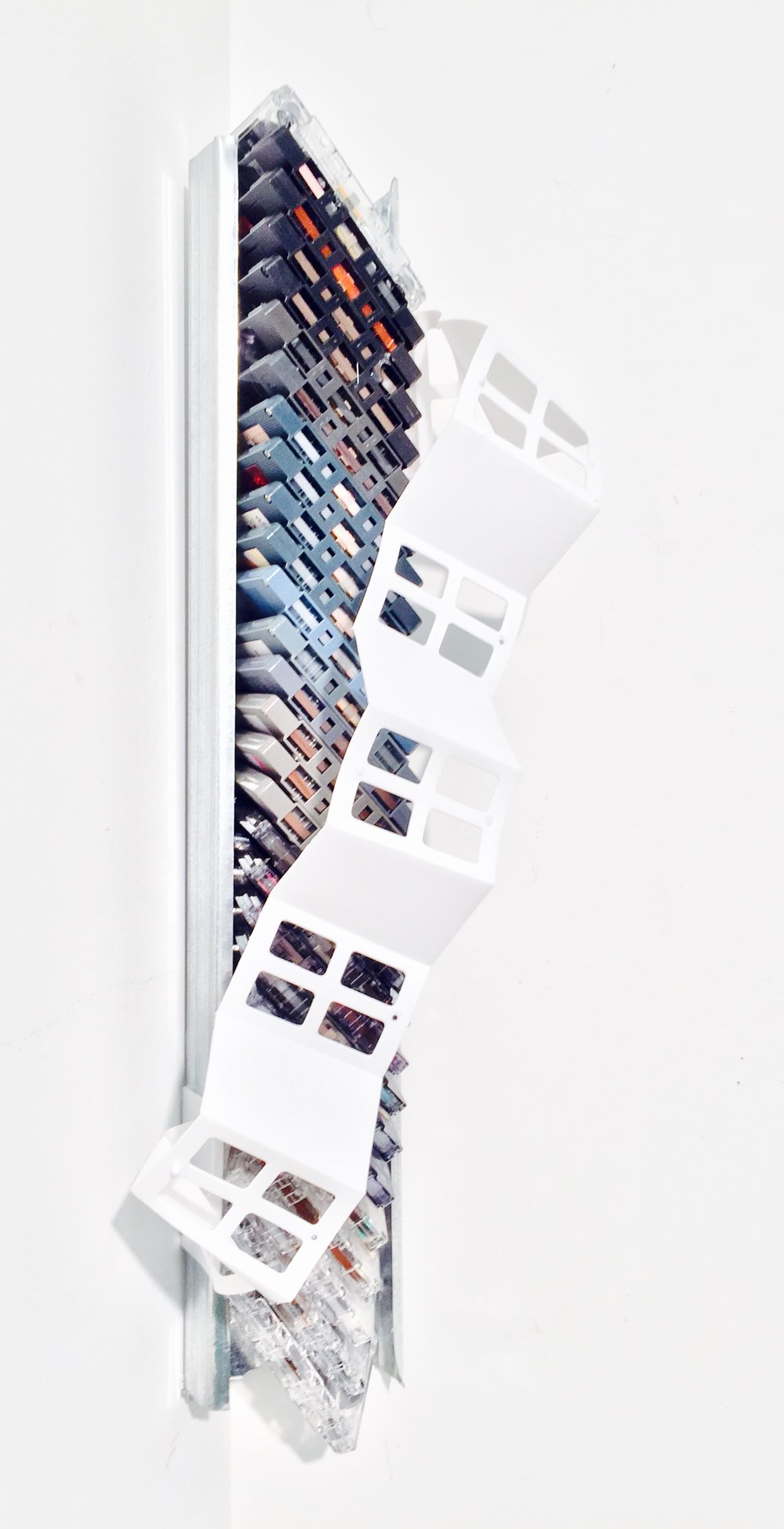 "Memory's DNA  (detail - left)  Cassette tape, aluminium ventilation ducting, found plastic  21 3/8"" x 8"" x 5"""