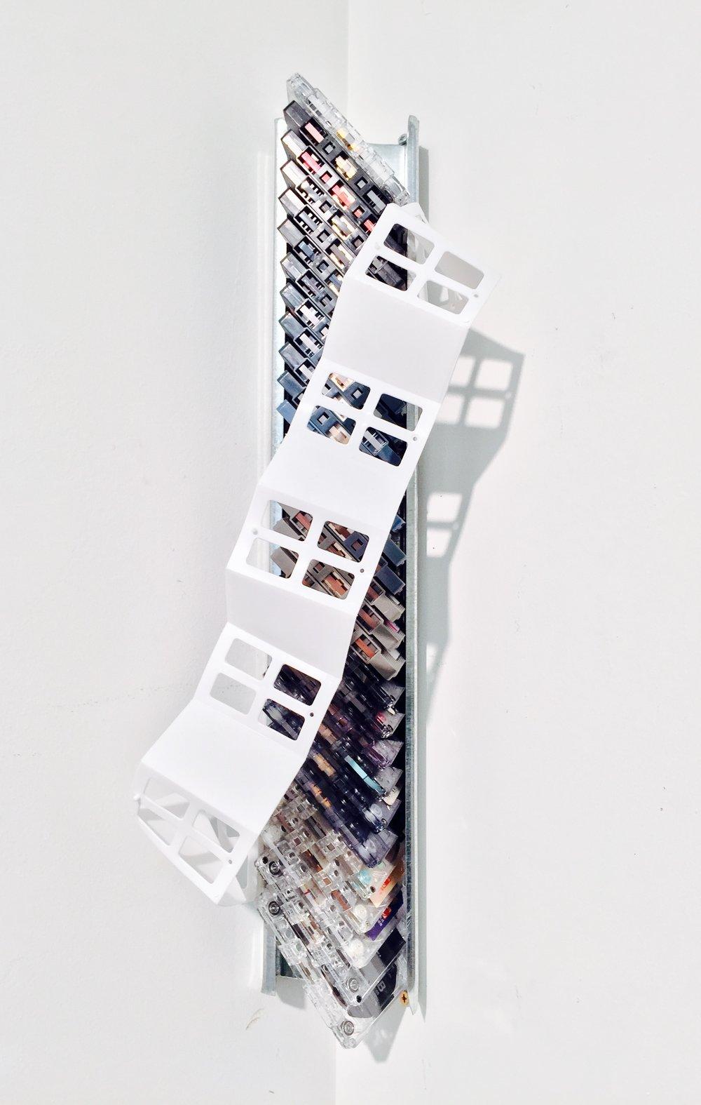 "Memory's DNA  (detail - front)  Cassette tape, aluminium ventilation ducting, found plastic  21 3/8"" x 8"" x 5"""