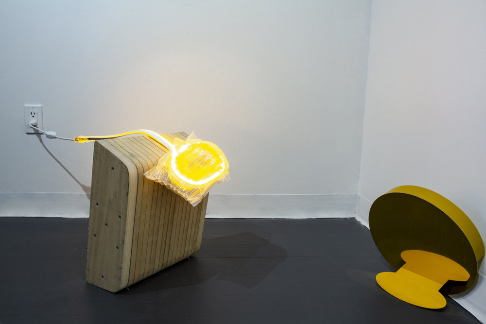 """You've also been naughty lately    Found wooden block and sculpture, LED light tube, used air bubble bag, screw  Left: Approx. 38"""" x 12 6/8"""" x 15 7/8""""  Right: Approx. 12"""" x 12"""" x 1 6/8"""""""