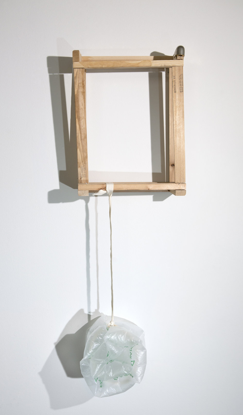 The burden    Found wooden frame and metal cap, used canvas tie and air bubble cushion, and T-pin  Approx. 39 x 13 x 10 inches