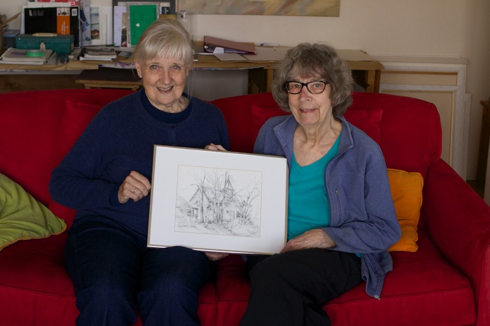 Barbara Wilson and painter, Marie Nagel (formerly of Wells) in Victoria with one of Barb's drawings.