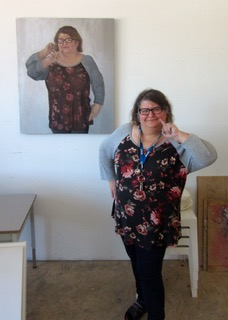 "Laurie stands in front of a piece from her new body of work ""Deafies""."