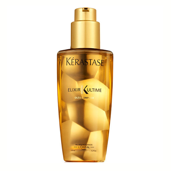 Kerastase Elixir Ultime Original Oil: Versatile nourishing oil that delivers deep conditioning and nourishment with 24 hours anti-humidity protection. Helps restore hair fiber, reduces split ends, resists breakage, and infuses four essential oils, adding softness and smoothness.