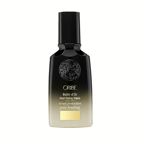Oribe Balm d'Or: Superlight styler with heat-activated polymer technology and healing cassis, sandalwood, and maracuja oils protects and nourishes fragile strands, sealing in sleekness and radiant shine while you blow-dry, straighten, or curl.