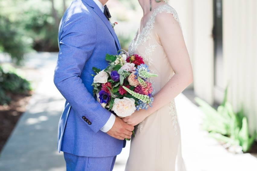 Florals of bride and groom during a first look.