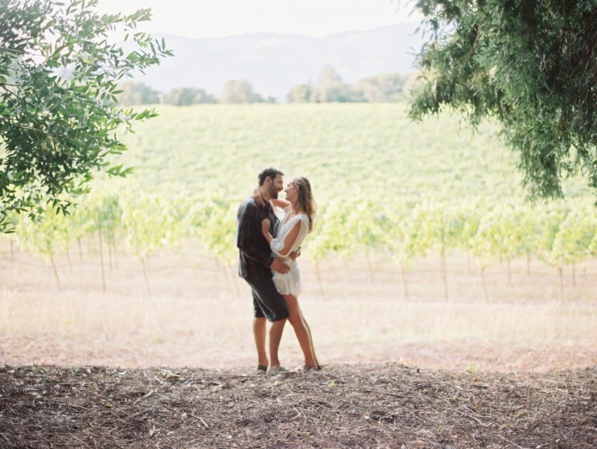 Engagement session in sonoma county vineyard.
