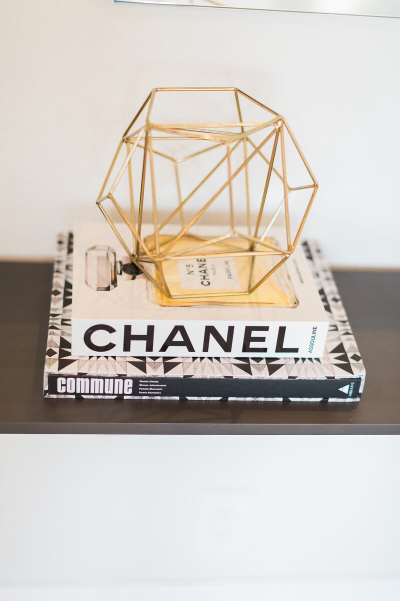 two books stacked namely Chanel and commune