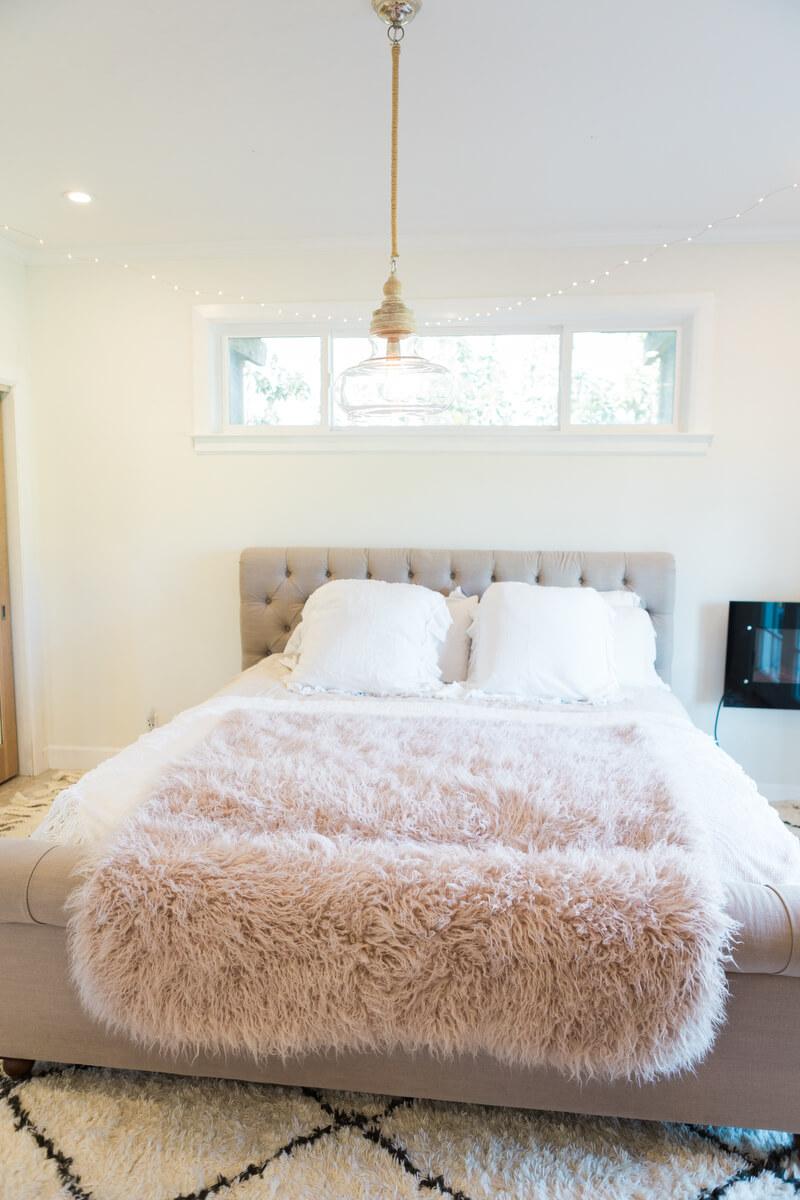 bed in bedroom post makeover