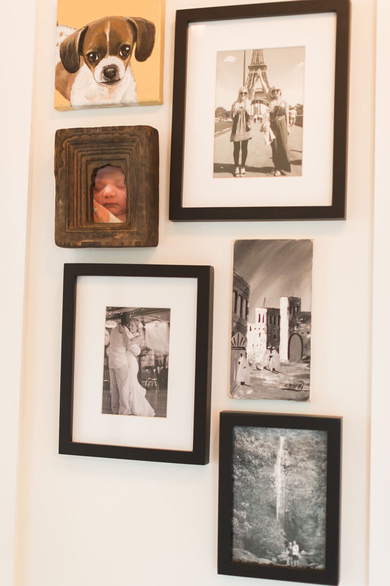 multiple photo frames on a wall