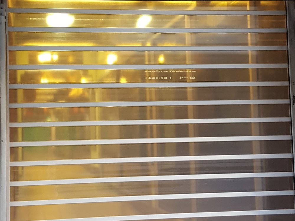 Clear commercial roller shutter in city arcade