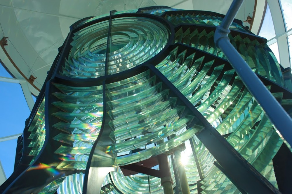 a lighthouse with a fresnel lens allows more light to be captured from oblique sources and therefore seen from greater distances