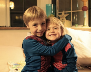 Smiles and hugs between Tricia's son and my daughter express my feeling about Tricia's kind of superheroism.