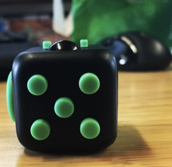 My coworker's new fidget cube. He contributed to the Kickstarter, so this is almost like a prototype.