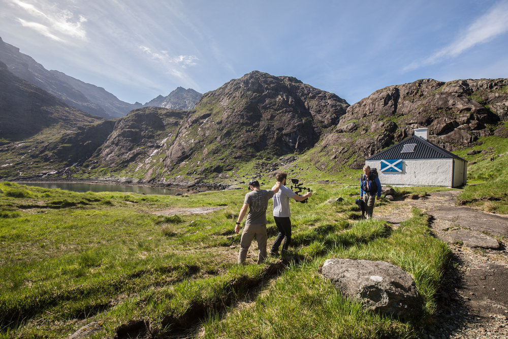 Ryan Goff shooting footage of Spike walking away from the Loch Coruisk hut, with Matt Hardy making sure the filming followed a steady path.