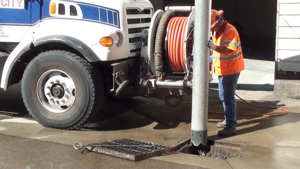 clean grate with vactor.jpg