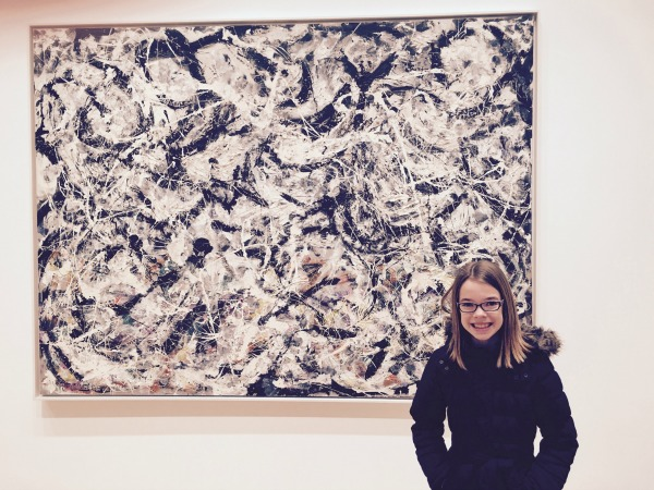 "Tess in front of a Jackson Pollock original. I'm sure there's all kinds of creativity I'm missing, but isn't that pretty much paint splattering? ""Here you go. That will be one million dollars."""