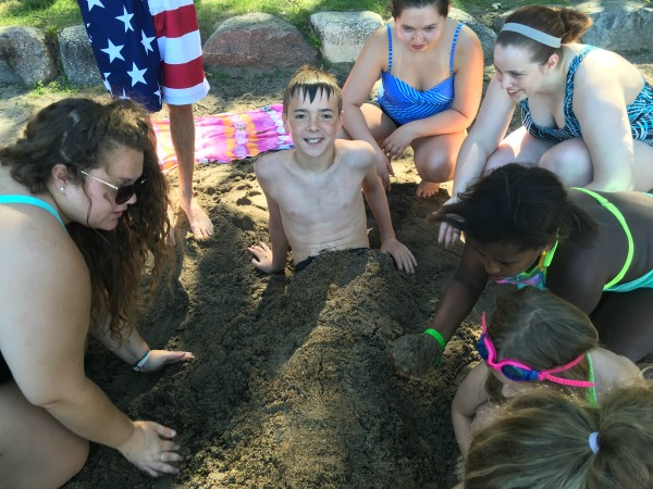 """Merman"" York being buried in the sand at Water Follies."
