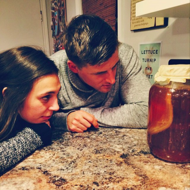 Friends Chelsea & Scott checking out  my homemade brew