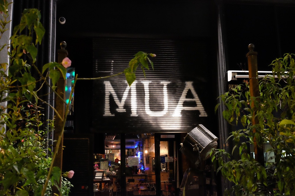 The restaurant's sign is illuminated by a vintage spotlight. Photo by Pam.