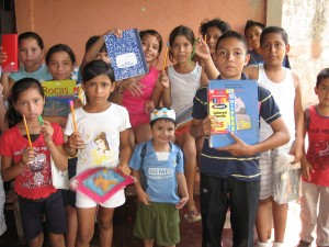 Children receive school supplies at Rosa's Biblioteca