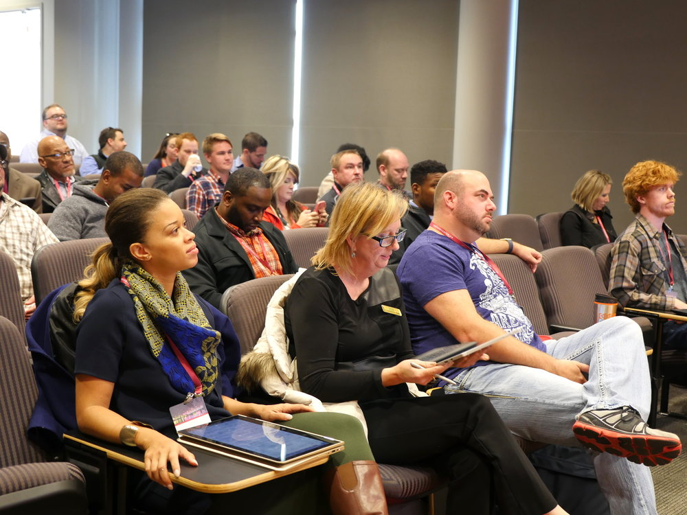 Bootcamp participants listen to and give digital feedback on one another's startup pitches.