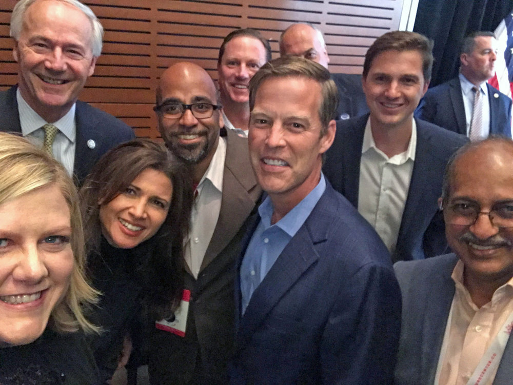Members of the 2017 VC FinTech cohort pose for a backstage selfie with Gov. Asa Hutchinson and FIS CEO Gary Norcross.