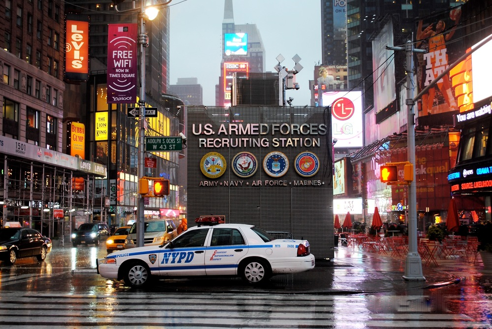 A police car parked in the middle of Times Square