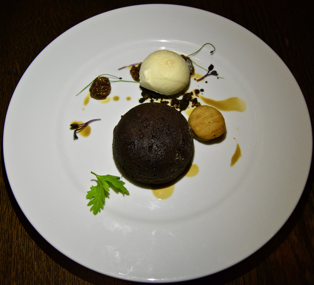 Soft walnut chocolate fondant, kahwa coffee biscuits, fig jam and orange ice cream (Alila Jabal Akhdar)