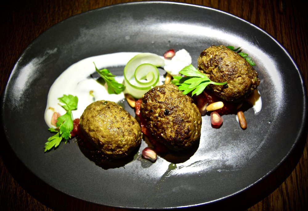 Wagyu beef and sour cherry kefta with smoked yoghurt, pickled cucumber and spiced nuts  (Alila Jabal Akhdar)