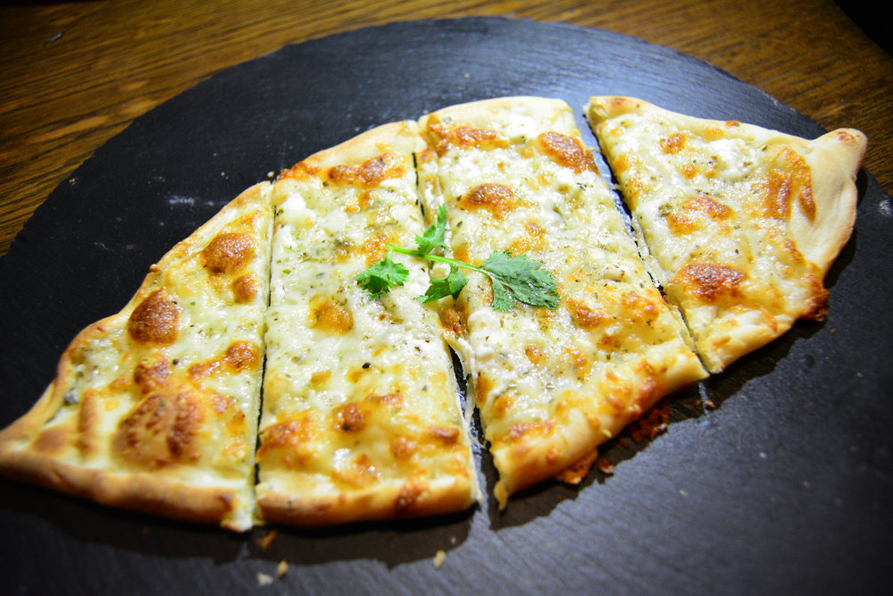Cheese pide with cherry tomato and parsley  (Alila Jabal Akhdar)