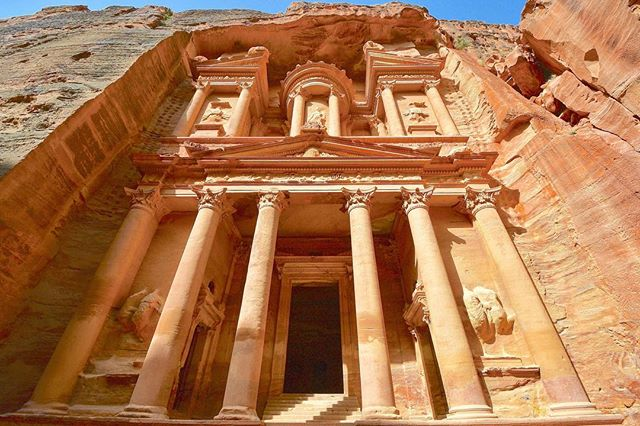 Petra is a world-renowned historical and archaeological site in Jordan's southwestern desert.  It was once a flourishing city in the heart of the ancient Near East.  It is believed that the earliest inhabitants of this mysterious area were the Horites (Genesis 14:6). Evidence indicates that Petra's first occupants were cave-dwellers. Esau, the brother of Jacob, settled in the area south of the Dead Sea. His descendants, the Edomites, eventually replaced the Horites (Genesis 36). The mountains of Edom still abound with caves, temples, and houses cut in the side of the mountain surrounding Petra. The Edomites built almost impregnable fortresses in the canyons and gorges of these mountains. The magnificent ruins at Petra attest to the greatness which Edom once knew. When the Israelites came from Egypt during the Exodus, about 1445 BC, the Edomites still occupied this region.  It was the Nabataeans who drove the Edomites out of the ancient city of Petra (approximately 400 BC). The Nabataeans were a group of Arabian nomads who led fruitful lives as desert traders. Few clues exist to reveal exactly where these migrants originated. It is puzzling why these successful, nomadic merchants settled down, shifting from a rural life to an urban lifestyle. Since the early Nabataeans were tent-dwellers, it is assumed that for the first several hundred years of their occupation of the region that they did not erect stone houses. It is only during the latter part of their kingdom that suddenly the Nabataeans began constructing houses -- often of incredible size, varying from 600 to 2000 square meters.  As many as 30,000 people may have occupied Petra during the 1st century A.D. A large earthquake in 363 A.D. destroyed at least half of the city. Petra never recovered from this destruction. It is believed that God predicted the demise of the inhabitants of Petra.  The prophet Obadiah describes the lofty places of Petra and the confidence of its inhabitants (Obadiah 2–4). Jeremiah prophesied that Petra would lose its power and become uninhabited (Jeremiah 49:16–18). . Source: https://www.allaboutarchaeology.org/petra-the-ancient-city.htm  #Petra #Jordan #TheHappyTravellers