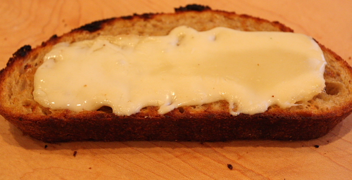 Melted Taleggio on toasted bread