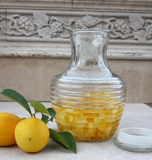 Lemons peels with alcohol inside jar