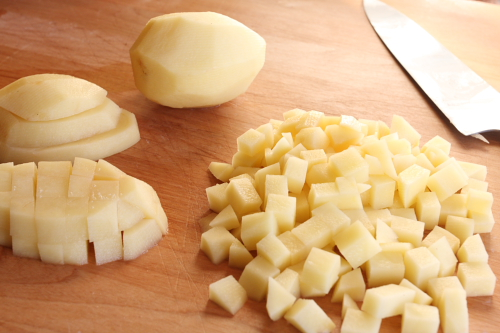 Chopping potatoes for soup