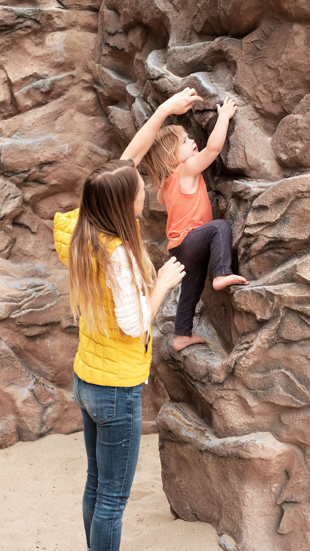 "Climbing a ""rock wall"" at the local playground."