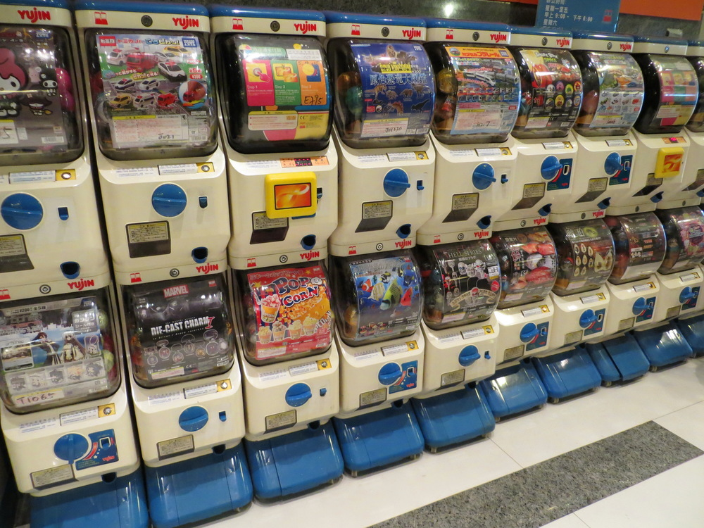 A row of Gacha machines; each has a different theme or IP
