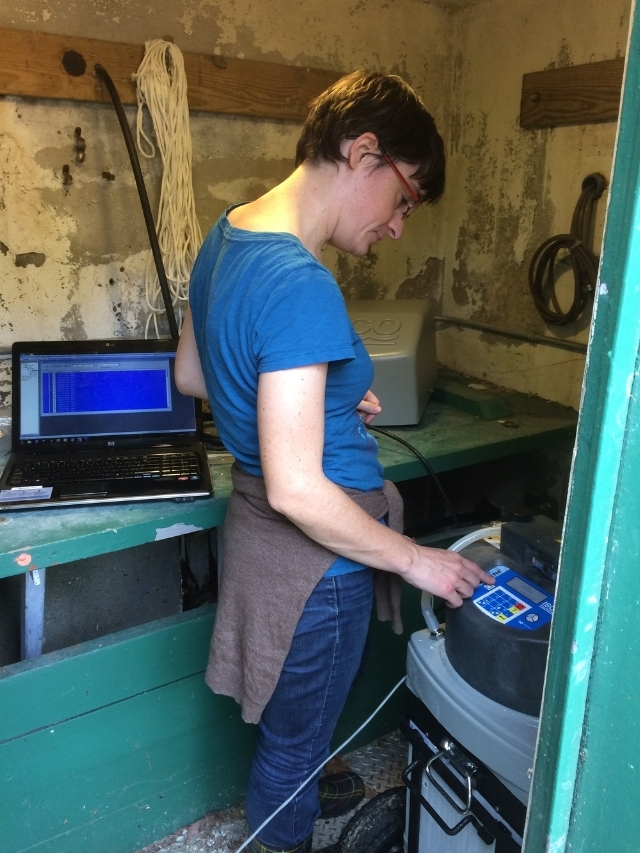 MyRWA scientist Veronique Vicard is programming the autosampler stationed at the Aberjona River.