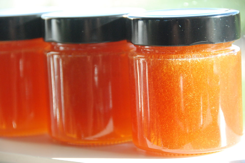 Honey is harvested, pressed and jarred.